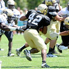 "Josh Ford, 42, breaks through Stephane Nembot, 90, and K..T. Tu'umalo, 42 during the University of Colorado Football team scrimmage on Saturday August 13, 2011.<br /> For more photos and video interviews from the scrimmage go to  <a href=""http://www.buffzone.com"">http://www.buffzone.com</a> and dailycamera.com<br /> Photo by Paul Aiken  August 13,  2011."