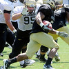"Tony Poremba, 95, gets a line on Rodney Stewart, 5,  during the University of Colorado Football team scrimmage on Saturday August 13, 2011.<br /> For more photos and video interviews from the scrimmage go to  <a href=""http://www.buffzone.com"">http://www.buffzone.com</a> and dailycamera.com<br /> Photo by Paul Aiken  August 13,  2011."
