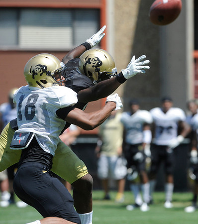 "Jonathan Hawkins, 18 bangs with Toney Clemons, 17, as the ball gets away during the University of Colorado Football team scrimmage on Saturday August 13, 2011.<br /> For more photos and video interviews from the scrimmage go to  <a href=""http://www.buffzone.com"">http://www.buffzone.com</a> and dailycamera.com<br /> Photo by Paul Aiken  August 13,  2011."