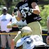 "Tyler McCulloch, 87, keeps his eye on the ball as he is defended by Paul Vigo, 32, during the University of Colorado Football team scrimmage on Saturday August 13, 2011.<br /> For more photos and video interviews from the scrimmage go to  <a href=""http://www.buffzone.com"">http://www.buffzone.com</a> and dailycamera.com<br /> Photo by Paul Aiken  August 13,  2011."