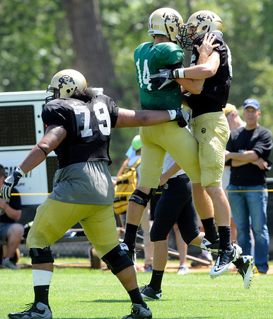 "John Schrock, 14, celebrates with Tyler McCulloch, 87, as they connected for a touchdown during the University of Colorado Football team scrimmage on Saturday August 13, 2011.<br /> For more photos and video interviews from the scrimmage go to  <a href=""http://www.buffzone.com"">http://www.buffzone.com</a> and dailycamera.com<br /> Photo by Paul Aiken  August 13,  2011."