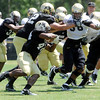 "Andre Nichols, 58, tries to get to Malcolm Creer, 44, during the University of Colorado Football team scrimmage on Saturday August 13, 2011.<br /> For more photos and video interviews from the scrimmage go to  <a href=""http://www.buffzone.com"">http://www.buffzone.com</a> and dailycamera.com<br /> Photo by Paul Aiken  August 13,  2011."