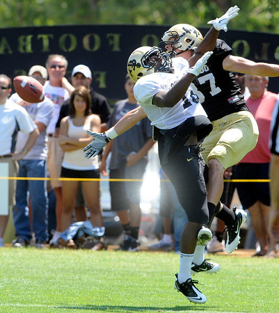 "Makiri Pugh, 16, keeps the ball away from Tyler McCulloch, 87, during the University of Colorado Football team scrimmage on Saturday August 13, 2011.<br /> For more photos and video interviews from the scrimmage go to  <a href=""http://www.buffzone.com"">http://www.buffzone.com</a> and dailycamera.com<br /> Photo by Paul Aiken  August 13,  2011."