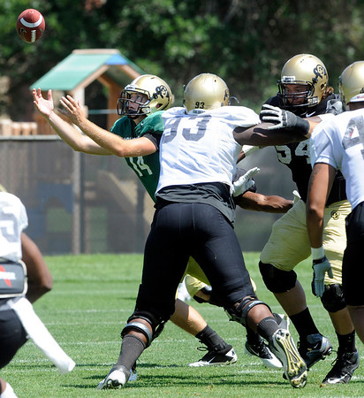 "Quarterback John Schrock, 14, tries to gather in a bad snap during the University of Colorado Football team scrimmage on Saturday August 13, 2011.<br /> For more photos and video interviews from the scrimmage go to  <a href=""http://www.buffzone.com"">http://www.buffzone.com</a> and dailycamera.com<br /> Photo by Paul Aiken  August 13,  2011."