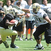"Kirk Poston, 91, prepares to tackle Tony Jones, 26, during the University of Colorado Football team scrimmage on Saturday August 13, 2011.<br /> For more photos and video interviews from the scrimmage go to  <a href=""http://www.buffzone.com"">http://www.buffzone.com</a> and dailycamera.com<br /> Photo by Paul Aiken  August 13,  2011."