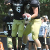 "Paul Richardson, 6, helps celebrate with Tyler McCulloch, 87, after McCulloch made a tough catch for a touchdown during the University of Colorado Football team scrimmage on Saturday August 13, 2011.<br /> For more photos and video interviews from the scrimmage go to  <a href=""http://www.buffzone.com"">http://www.buffzone.com</a> and dailycamera.com<br /> Photo by Paul Aiken  August 13,  2011."
