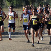 Many of the Colorado runners came across the line in a group. Joe Bosshard (63) of CU was the first finisher in the 8K.<br /> Cliff Grassmick / September 5, 2009
