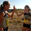 Allison Sawyer, left, gets a high five from Jenny Barringer after the pair finished the 5.8K run.<br /> Cliff Grassmick / September 5, 2009