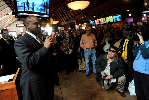 "Newly-named CU football coach Jon Embree greets fans at the reception hosted by the University of Colorado at the Blake Street Tavern in downtown Denver. CU mascot ""Ralphie"" even made the trip from Boulder to Denver for the party. Kathryn Scott Osler, The Denver Post"