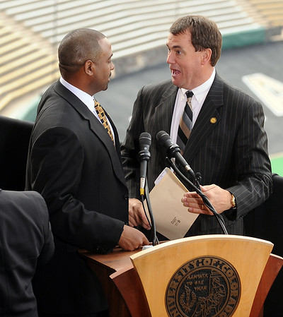 "CU head coach, Jon Embree, left, and Athletic Director, Mike Bohn, after the press conference.<br /> For more photos of the press conference, go to  <a href=""http://www.dailycamera.com"">http://www.dailycamera.com</a>.<br /> Cliff Grassmick / December 6, 2010"