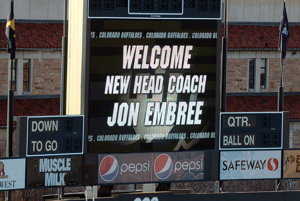 """A sign of the times in Folsom Field.<br /> For more photos of the press conference, go to  <a href=""""http://www.dailycamera.com"""">http://www.dailycamera.com</a>.<br /> Cliff Grassmick / December 6, 2010"""
