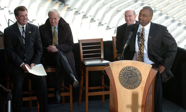 """Athletic Director, Mike Bohn, left, CU President, Bruce Benson, and Chancellor, Phil DiStephano, listen to new football coach, Jon Embree.<br /> For more photos of the press conference, go to  <a href=""""http://www.dailycamera.com"""">http://www.dailycamera.com</a>.<br /> Cliff Grassmick / December 6, 2010"""
