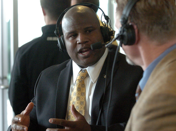"""Eric Bieniemy is interviewed on KOA Radio.<br /> For more photos of the press conference, go to  <a href=""""http://www.dailycamera.com"""">http://www.dailycamera.com</a>.<br /> Cliff Grassmick / December 6, 2010"""