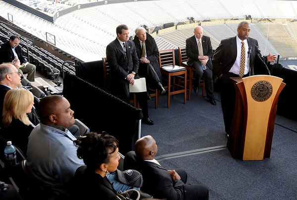 "Jon Embree, right, addresses the media at his press conference on Monday.<br /> For more photos of the press conference, go to  <a href=""http://www.dailycamera.com"">http://www.dailycamera.com</a>.<br /> Cliff Grassmick / December 6, 2010"
