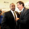 """New CU football coach, Jon Embree, left, is greeted by former teammate, Ed Reinhardt, during Embree's press conference.<br /> For more photos of the press conference, go to  <a href=""""http://www.dailycamera.com"""">http://www.dailycamera.com</a>.<br /> Cliff Grassmick / December 6, 2010"""