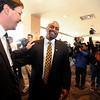 """New CU football coach, Jon Embree, center, is greeted by former teammate, Ed Reinhardt, during Embree's press conference.<br /> For more photos of the press conference, go to  <a href=""""http://www.dailycamera.com"""">http://www.dailycamera.com</a>.<br /> Cliff Grassmick / December 6, 2010"""