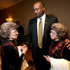 1206JON.jpg Sisters Betty Hoover (left) and Peggy Coppom (right) greet and welcome new University of Colorado football head coach Jon Embree (center) reception held in his honor at the Omni Interlocken Resort in Broomfield, Colorado December 6, 2010.  CAMERA/Mark Leffingwell