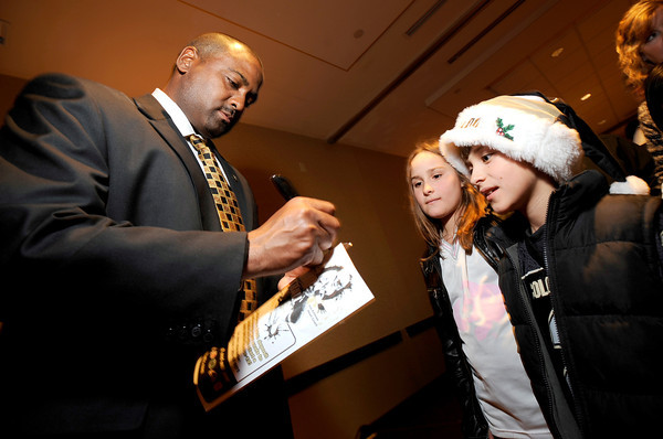 1206JON2.jpg Davis Long (right), 9, and Natalie Long (center), 10, get an autograph from new University of Colorado football head coach Jon Embree (left) reception held in his honor at the Omni Interlocken Resort in Broomfield, Colorado December 6, 2010.  CAMERA/Mark Leffingwell