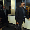 New CU Football Coaches10.JPG New University of Colorado football coaches, Jon Embree,  right, and Eric Bieniemy arrive at  the Denver Air Center in Broomfield on Sunday night. They will be introduced at 10 a.m. Monday at Folsom Field.<br /> Cliff Grassmick / December 5, 2010