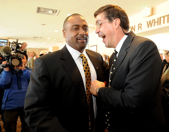 """Jon Embree Presser302.JPG New CU football coach, Jon Embree, left, is greeted by former teammate, Ed Reinhardt, during Embree's press conference.<br /> For more photos of the press conference, go to  <a href=""""http://www.dailycamera.com"""">http://www.dailycamera.com</a>.<br /> Cliff Grassmick / December 6, 2010"""