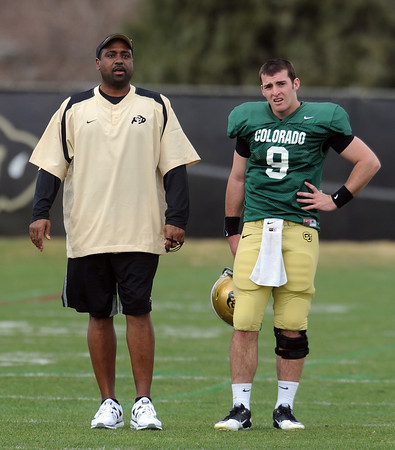"""CU Spring Football April 2011 136.JPG Colorado football coach, Jon Embree, works with Tyler Hansen during the scrimmage on Saturday.<br /> For more photos and a video of Embree, go to  <a href=""""http://www.dailycamera.com"""">http://www.dailycamera.com</a>.<br /> Cliff Grassmick/ April 2, 2011"""
