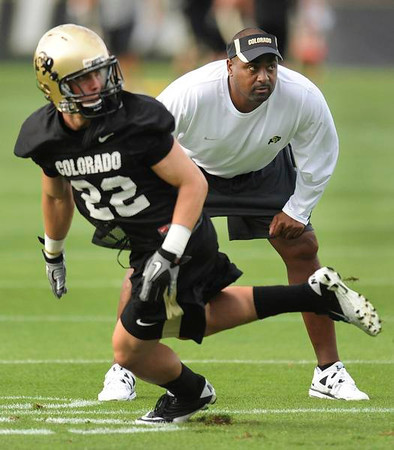 buffs.jpg Buffs coach Jon Embree watched the quarterback as receiver Nelson Spruce (22) made the cut on his route during drills Thursday night in Boulder.  The University of Colorado football team began the 2011 campaign with a practice session Thursday evening, August 4, 2011.   Karl Gehring/ The Denver Post