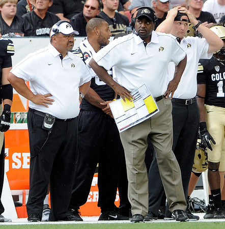 """CU vs CSU015.JPG University of Colorado Head Coach Jon Embree, center, looks at the scoreboard in the final seconds of the Rocky Mountain Showdown against Colorado State University on Saturday, Sept. 1, at Sports Authority Field at Mile High in Denver. CSU won the game 22-17. For more photos of the game go to  <a href=""""http://www.dailycamera.com"""">http://www.dailycamera.com</a><br /> Jeremy Papasso/ Camera"""