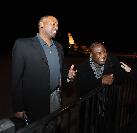 New CU Football Coaches2.JPG New University of Colorado football coaches, Jon Embree, left, and Eric Bieniemy arrive at Denver Air Center in Broomfield on Sunday night. They will be introduced at 10 a.m. Monday at Folsom Field.<br /> Cliff Grassmick / December 5, 2010