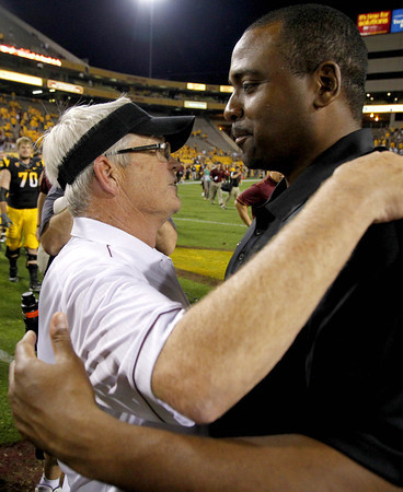 Colorado Arizona St Footbal (5).JPG Arizona State's Dennis Erickson, left, hugs Colorado's Jon Embree after an NCAA college football game Saturday, Oct. 29, 2011, in Tempe, Ariz.  Arizona State defeated Colorado 48-14. (AP Photo/Ross D. Franklin)