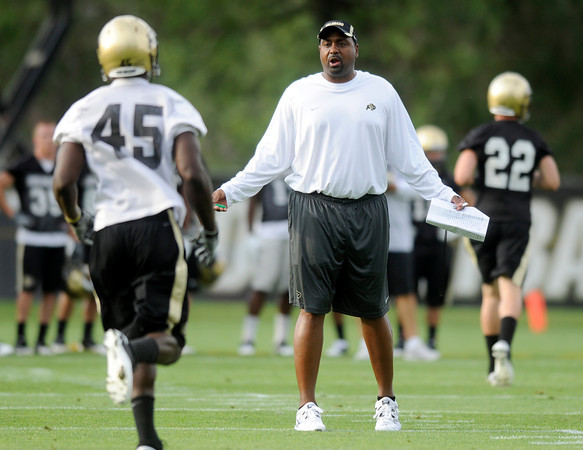 "CU Football Practice017.JPG University of Colorado Head Coach Jon Embree questions linebacker Lowell Williams after a play on Thursday, Aug. 4, during the Buff's first football practice on the University of Colorado practice field in Boulder. For more photos and interviews from the practice go to  <a href=""http://www.dailycamera.com"">http://www.dailycamera.com</a><br /> Jeremy Papasso/ Camera"