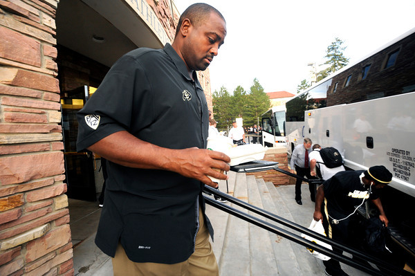 CULEAVES7.jpg CU Head Coach Jon Embree boards a bus outside the Dal Ward Center on Thursday as the team begins the trip for  their season opening game in Hawaii.<br /> Thursday September 1, 2011<br /> Photo by Paul Aiken / The Camera / September 1  2011