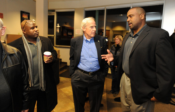 New CU Football Coaches55.JPG New University of Colorado football coaches, Jon Embree,right, and Eric Bieniemy, talks to CU President Bruce Benson, after arriving at Denver Air Center in Broomfield on Sunday night. They will be introduced at 10 a.m. Monday at Folsom Field.<br /> Cliff Grassmick / December 5, 2010