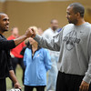 "2012 CU Pro Timing Day370.JPG  CU football coach, Jon Embree, congratulates Anthony Perkins after his workout for the pros.<br /> University of Colorado football players showed their skills to NFL scouts on Thursday during CU pro timing day.<br /> For a video and more photos of timing day, go to  <a href=""http://www.dailycamera.com"">http://www.dailycamera.com</a>.<br /> Cliff Grassmick / March 8, 2012"