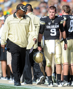 Colorado Oregon Football345.JPG Jon Embree checks in with CU QB Tyler Hansen after his injury, a possible concussion. For more photos of the game, go to www.dailycamera.com. October 22, 2011 / Cliff Grassmick