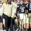 "Colorado Oregon Football345.JPG Jon Embree checks in with CU QB Tyler Hansen after his injury, a possible concussion.<br /> For more photos of the game, go to  <a href=""http://www.dailycamera.com"">http://www.dailycamera.com</a>.<br /> October 22, 2011 / Cliff Grassmick"