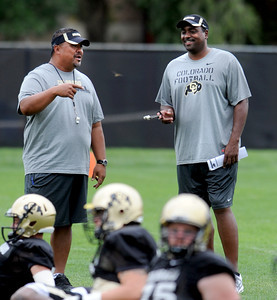 Colorado Football Practice August 26, 2011 64.JPG Head coach Jon Embree, right, and assistant, Mike Tuiasosopo, joke during practice on Friday, August 26, 2011. For more photos of CU football, go to www.dailycamera.com. Cliff Grassmick / August 26, 2011