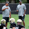 "Colorado Football Practice August 26, 2011 64.JPG Head coach Jon Embree, right, and assistant, Mike Tuiasosopo, joke during practice on Friday, August 26, 2011.<br /> For more photos of CU football, go to  <a href=""http://www.dailycamera.com"">http://www.dailycamera.com</a>.<br /> Cliff Grassmick / August 26, 2011"