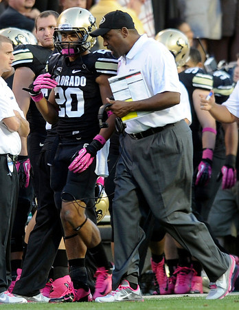 "CU vs UCLA001.JPG University of Colorado head coach Jon Embree talks with Greg Henderson on the sideline during a game against UCLA on Saturday, Sept. 29, at Folsom Field in Boulder. For more photos of the game go to  <a href=""http://www.dailycamera.com"">http://www.dailycamera.com</a><br /> Jeremy Papasso/ Camera"