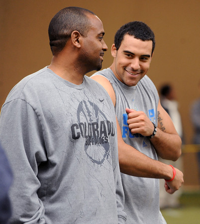 "2012 CU Pro Timing Day354.JPG  CU football coach, Jon Embree, jokes with his son, Taylor, during timing day in Boulder.<br /> University of Colorado football players showed their skills to NFL scouts on Thursday during CU pro timing day.<br /> For a video and more photos of timing day, go to  <a href=""http://www.dailycamera.com"">http://www.dailycamera.com</a>.<br /> Cliff Grassmick / March 8, 2012"