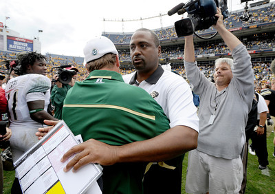 CU CSU 2011 Football153.JPG CU head coach Jon Embree hugs Steve Fairchild after the Buffs win, the first for Embree. For more photos of the CU game, go to www.dailycamera.com.  Cliff Grassmick / September 17, 2011
