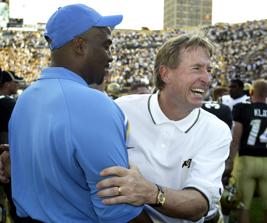 AP03090605454.jpg Colorado head coach Gary Barnett, right, smiles as he meets with former Colorado assistant coach and current UCLA assistant coach Jon Embree following Colorado's 16-14 victory at Folsom Field in Boulder, Colo., Saturday, Sept. 6, 2003.  (AP Photo/Jack Dempsey)