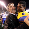 San Jose State coach Mike MacIntyre  celebrates with cornerback Jimmy Pruitt (8) after their 52-43 win over Louisiana Tech during an NCAA college football game in San Jose, Calif., Saturday, Nov. 24, 2012.(AP Photo/Tony Avelar)