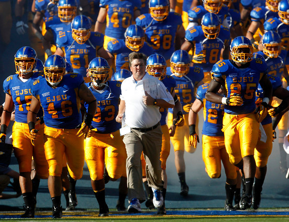 ssjm0916sjsufbc32.jpg San Jose State University Spartans head coach Mike MacIntyre leads his team onto the field before their game against the Colorado State University Rams at Spartan Stadium in San Jose, Calif. on Saturday, Sept. 15, 2012.  (Nhat V. Meyer/Staff)