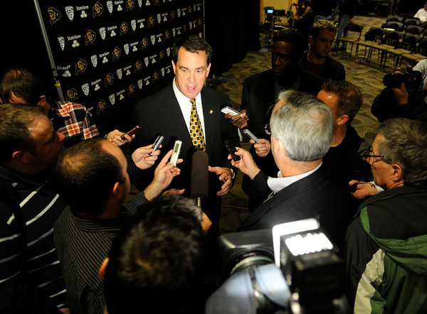 "University of Colorado Athletic Director Mike Bohn gives an interview to reporters regarding new head football coach Mike MacIntyre during a press conference in the club level of Folsom Field on Monday, Dec. 10, on the CU campus in Boulder. For more photos and video of the press conference go to  <a href=""http://www.dailycamera.com"">http://www.dailycamera.com</a><br /> Jeremy Papasso/ Camera"