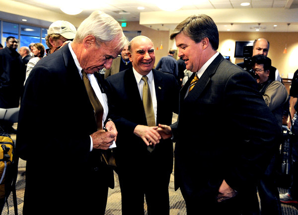 CU President, Bruce Benson, left, CU Chancellor, Phil DiStefano, and new coach, Mike MacIntyre, exchange contact information.<br /> Mike MacIntyre is officially named the next football coach at the University of Colorado.<br /> Cliff Grassmick / December10, 2012