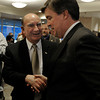"University of Colorado's new football head coach Mike MacIntyre shakes hands with Chancellor Phil DiStefano during a press conference in the club level of Folsom Field on Monday, Dec. 10, on the CU campus in Boulder. For more photos and video of the press conference go to  <a href=""http://www.dailycamera.com"">http://www.dailycamera.com</a><br /> Jeremy Papasso/ Camera"