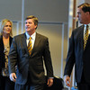 CU AD Mike Bohn, right, brings in new CU football coach, Mike MacIntyre and his wife, Trisha.<br /> Mike MacIntyre is officially named the next football coach at the University of Colorado.<br /> Cliff Grassmick / December10, 2012