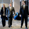 "University of Colorado Athletic Director Mike Bohn, right, walks with new head football coach Mike MacIntyre and his wife Trisha at the start of a press conference in the club level of Folsom Field on Monday, Dec. 10, on the CU campus in Boulder. For more photos and video of the press conference go to  <a href=""http://www.dailycamera.com"">http://www.dailycamera.com</a><br /> Jeremy Papasso/ Camera"
