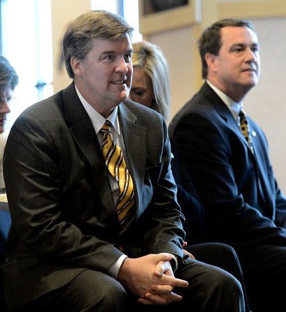 "University of Colorado head coach Mike MacIntyre, left, sits next to Athletic Director Mike Bohn during a press conference in the club level of Folsom Field on Monday, Dec. 10, on the CU campus in Boulder. For more photos and video of the press conference go to  <a href=""http://www.dailycamera.com"">http://www.dailycamera.com</a><br /> Jeremy Papasso/ Camera"