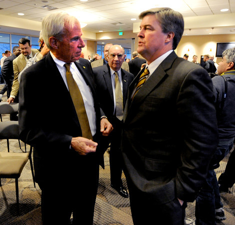 University of Colorado President, Bruce Benson, talks to new football coach, Mike MacIntyre.<br /> Mike MacIntyre is officially named the next football coach at the University of Colorado.<br /> Cliff Grassmick / December10, 2012